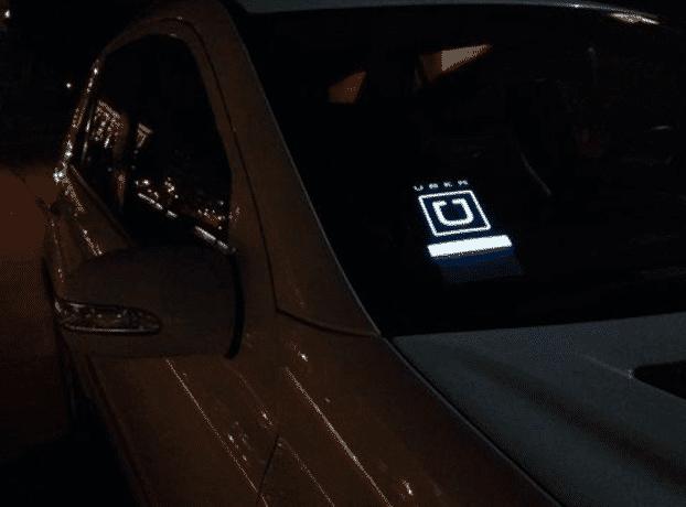 uber driver blue white car light signs